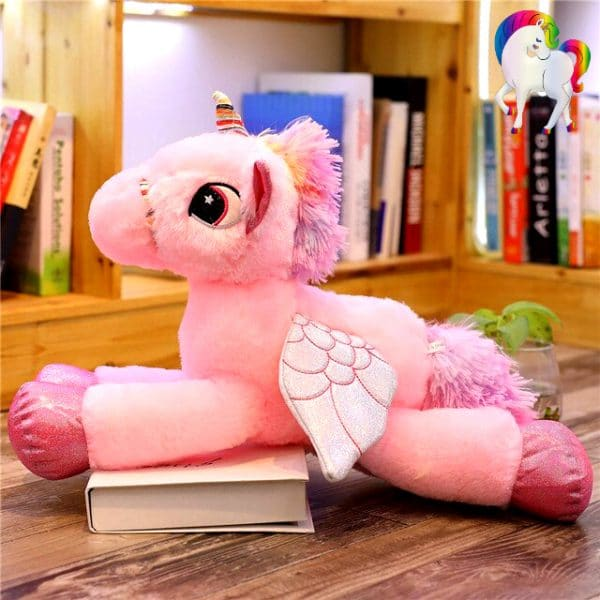 PELUCHE LICORNE YEUX BRILLANTS ROSE